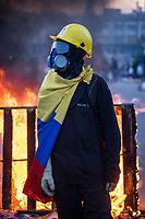 BOGOTA - COLOMBIA, 20-07-2021: <br /> Un joven de primera línea posa para una foto en el sector de Usme durante los disturbios hoy, 20 de julio de 2021, en Bogotá durante la conmemoración del día de independencia de Colombia en el cual siguen las protestas del paro nacional que nuevamente convocó movilizaciones para protestar por el gobierno del presidente Duque. / A young man from the front line poses for a photo in the Usme sector during the riots today, July 20, 2021, in Bogotá during the commemoration of Colombia's independence day in which the protests of the national strike that again called mobilizations to protest the government of President Duque. Photo: VizzorImage / Diego Cuevas / Cont