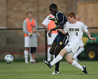 Sean McGrath #4 of the University of Notre Dame knocks the ball away from Kofi Opare #6 of the University of Michigan during a men's NCAA match at the new Alumni Stadium on September 1 2009 in South Bend, Indiana. Notre Dame won 5-0.