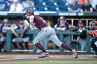 Mississippi State Bulldogs outfielder Jake Mangum (15) lays down a bunt during Game 10 of the NCAA College World Series against the Louisville Cardinals on June 20, 2019 at TD Ameritrade Park in Omaha, Nebraska. Louisville defeated Mississippi State 4-3. (Andrew Woolley/Four Seam Images)