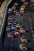 Cars make their way down the front stretch during the Bank of America 500 NASCAR race at Lowes's Motor Speedway in Concord, NC.