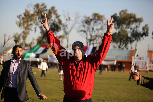 Ahmed Shobir, the former Egyptian goalkeeper marks victory sign during a football match with Palestinian Prime Minister in Gaza strip Ismail Haniyeh, in Gaza city on 13 January 2013. The Egyptian minister of sports, Al-Ameri Farouk, arrived in Gaza on Saturday evening at the head of a large delegation of sportsmen and sports officials. The visit would aim at boosting sports relations and renewing sports agreements, describing the visit as a step toward ending the sports siege on the Strip, Farouk said. Photo by Majdi Fathi