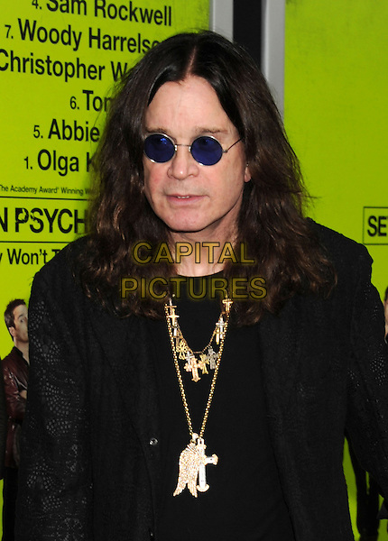 """Ozzy Osbourne.""""Seven Psychopaths"""" Los Angeles Premiere held at the Bruin Theatre, Westwood, California, USA..October 1st, 2012.half length black coat suit blazer gold necklaces sunglasses shades  .CAP/ROT/TM.© TM/Roth/Capital Pictures"""