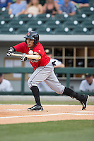 Gustavo Nunez (12) of the Indianapolis Indians bunts the ball during the game against the Charlotte Knights at BB&T BallPark on June 20, 2015 in Charlotte, North Carolina.  The Knights defeated the Indians 6-5 in 12 innings.  (Brian Westerholt/Four Seam Images)