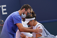 3rd April 2021; Miami Gardens, Miami, Florida, USA;  Coach Isade Juneau, left, and Bianca Andreescu (CAN). Bianca is injured and has to forfeit the women's final match of the Miami Open on April 3, 2021, at Hard Rock Stadium in Miami Gardens, Florida.