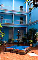 Courtyard colorful in small hotel downtown in Cienfurgos Cuba