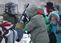 Demonstrators push on riot police officers as students protest tuition hikes Thursday, March 1, 2012 in front of the legislature in Quebec City<br /> <br /> PHOTO :  Francis Vachon - Agence Quebec Presse