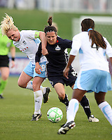 Lisa De Vanna of the Washington Freedom squeezes past Frida Ostberg and Ifeoma Dieke of the Chicago Red Stars during a WPS match at Maryland Soccerplex on April 11 2009, in Boyd's, Maryland.  The game ended in a 1-1 tie.