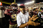 Florida State head coach Willie Taggart celebrates with his players after defeating North Carolina State 31-13 in an NCAA college football game in Tallahassee, Fla., Saturday, Sept. 28, 2019.    (AP Photo/Mark Wallheiser)