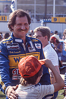 Dale Earnhardt talks with a young fan before the Pepsi Firecracker 400 at Daytona International Speedway, Daytone Beach, FL, July 4, 1985. (Photo by Brian Cleary/bcpix.com)