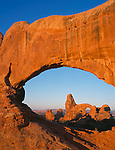 Arches National Park, UT<br /> Turret arch viewed thrut North Window arch in morning light