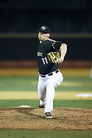 Wake Forest Demon Deacons relief pitcher Shane Muntz (11) in action against the Notre Dame Fighting Irish at David F. Couch Ballpark on March 10, 2019 in  Winston-Salem, North Carolina. The Fighting Irish defeated the Demon Deacons 8-7 in 10 innings in game two of a double-header. (Brian Westerholt/Four Seam Images)
