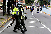 BOGOTA, COLOMBIA - MAY 05 : Police officers walk during the National strike on May 5, 2021 in the outskirts of Bogota, Colombia. Ahead of further planned protest in the country, Amnesty International has published evidence of excessive use of force being used against protesters by the security forces United Nations, European Union and rights bodies joined at criticism, official data show  19 people were killed and 846 injured during  clashes with the security forces. (Photo by Leonardo Munoz/VIEWpress)