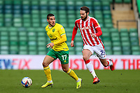 13th February 2021; Carrow Road, Norwich, Norfolk, England, English Football League Championship Football, Norwich versus Stoke City; Emi Buendia of Norwich City is under pressure from Nick Powell of Stoke City