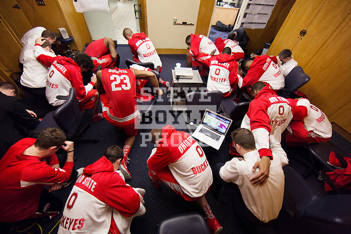 team says an Our Father prayer before heading out to the floor