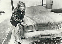 1978<br />  FILE PHOTO - ARCHIVES -<br /> <br /> Cars parked along lakeshore area in west end were caked with up to 3 inches of frozen spray whipped up by hurricane-force winds yesterday. Ray Russell's frozen hair was almost a match as he measured ice on a car parked at Boulevard Club. It was believed to be worst-damaged building in Metro from storm. Gusts up to 120 km/h (72 m.p.h.) struck Metro area; the strongest gust registered in Ontario yesterday was 150 km/h (90 m.p.h.) at Trenton.<br /> <br /> Bezant, Graham<br /> Picture, 1978,<br /> <br /> 1978<br /> <br /> PHOTO : Graham Bezant - Toronto Star Archives - AQP