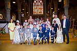 Ms Herlihys previously Ms Griffins Pupils of CBS Primary School, Tralee with their teachers, Denis Coleman (principal),Ciara Griffin and Fiona Herlihy and Fr Tadhg Fitzgerald after their First Holy Communion in St John's Church, Tralee on Saturday.