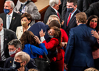 Newly sworn in House members mingle and congratulate each other on the opening day of the 117th Congress at the at the U.S. Capitol in Washington, DC on January 03, 2021. <br /> CAP/MPI/RS<br /> ©RS/MPI/Capital Pictures