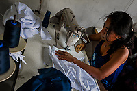 A Salvadoran seamstress sews a white fabric, dyed with the natural blue indigo afterwards, in an artisanal clothing workshop in Santiago Nonualco, El Salvador, 6 April 2018. For centuries, indigo, a natural deep blue dye extracted from the leaves of tropical plants, has been known to the native indigenous inhabitants of Central America. Nowadays, a growing demand for handmade, nature-based products has has permitted the emergence of various clothing workshops and cooperatives. Employing traditional design techniques and inspired by the ancient Mayan artists, they produce fashion collections, clothing accessories or decorative items on a sustainable, small scale basis.