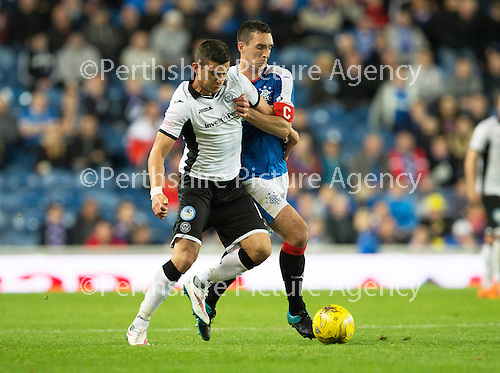 Rangers v St Johnstone...22.09.15  Scottish League Cup Round 3, Ibrox Stadium<br /> Graham Cummins and Lee Wallace<br /> Picture by Graeme Hart.<br /> Copyright Perthshire Picture Agency<br /> Tel: 01738 623350  Mobile: 07990 594431