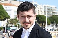 Alexej Manvelov pose lors du photocall de BEFORE WE DIE pendant le MIPTV a Cannes, le lundi 3 avril 2017.