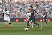 SAINT PAUL, MN - JUNE 23: Adrien Hunou #23 of Minnesota United FC plays the ball forward during a game between Austin FC and Minnesota United FC at Allianz Field on June 23, 2021 in Saint Paul, Minnesota.