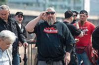 """Am Samstag den 26. April 2014 versuchte die Neonazipartei NPD in Berlin erneut einen Aufmarsch durch den Stadtteil Kreuzberg. 6.000 Menschen protestierten mit diversen Blokade dagegen und verhinderten, dass die ca 70 Neonazis weiter als 150m laufen konnten.<br /> So war nach 3 Minuten Marsch für die NPD Schluss und die Neonazis mussten zum Startpunkt am S-Bahnhof Jannowitzbruecke umdrehen. Auch wenn ueber den NPD-Lautsprecherwagen mehrfach behauptet wurde, die Demonstration sei in Kreuzberg, ist doch richtig, dass die Neonazis sich nur in Berlin-Mitte befanden.<br /> Im Bild: Uwe Dreisch, Anfuehrer der verbotenen Neonaziorganisation """"Frontbann 24"""" und Anfuehrer der Neonazipartei """"Die Rechte Berlin"""" traegt ein T-Shirt mit der Aufschrift """"Rueckfuehrungsbeauftragter - Ihr Partner in Sachen Transportlogistik"""".<br /> 26.4.2014, Berlin<br /> Copyright: Christian-Ditsch.de<br /> [Inhaltsveraendernde Manipulation des Fotos nur nach ausdruecklicher Genehmigung des Fotografen. Vereinbarungen ueber Abtretung von Persoenlichkeitsrechten/Model Release der abgebildeten Person/Personen liegen nicht vor. NO MODEL RELEASE! Don't publish without copyright Christian-Ditsch.de, Veroeffentlichung nur mit Fotografennennung, sowie gegen Honorar, MwSt. und Beleg. Konto:, I N G - D i B a, IBAN DE58500105175400192269, BIC INGDDEFFXXX, Kontakt: post@christian-ditsch.de<br /> Urhebervermerk wird gemaess Paragraph 13 UHG verlangt.]"""