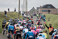 peloton coming off the Paddestraat<br /> <br /> 104th Ronde van Vlaanderen 2020 (1.UWT)<br /> 1 day race from Antwerpen to Oudenaarde (BEL/243km) <br /> <br /> ©kramon
