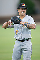 Trace Tam Sing (6) of the West Virginia Power warms up in the outfield prior to the game against the Kannapolis Intimidators at Intimidators Stadium on July 3, 2015 in Kannapolis, North Carolina.  The Intimidators defeated the Power 3-0 in a game called in the bottom of the 7th inning due to rain.  (Brian Westerholt/Four Seam Images)