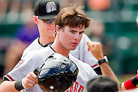 Jesse Winker (23) of the Billings Mustangs high fives teammates after scoring a run against the Grand Junction Rockies at Suplizio Field on July 25, 2012 in Grand Junction, Colorado.  The Mustangs defeated the Rockies 12-11 in 10 innings.  (Brian Westerholt/Four Seam Images)