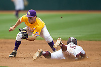 LSU Tigers shortstop Alex Bregman (30) waits for the catchers throw as Texas A&M Aggies baserunner Mikey Reynolds (16) steals second base in the NCAA Southeastern Conference baseball game on May 11, 2013 at Blue Bell Park in College Station, Texas. LSU defeated Texas A&M 2-1 in extra innings to capture the SEC West Championship. (Andrew Woolley/Four Seam Images).