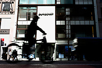 NEW YORK, NEW YORK - MARCH 12: A man rides his bike in front the Burberry store on March 12, 2021 in New York. Burberry expects full-year profits to beat market forecasts after a rebound in sales in the fourth quarter, sending its shares more than 6% higher. (Photo by Emaz/VIEWpress)