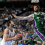 Real Madrid´s Felipe Reyes and Unicaja´s Stefan Markovic during 2014-15 Liga Endesa match between Real Madrid and Unicaja at Palacio de los Deportes stadium in Madrid, Spain. April 30, 2015. (ALTERPHOTOS/Luis Fernandez)