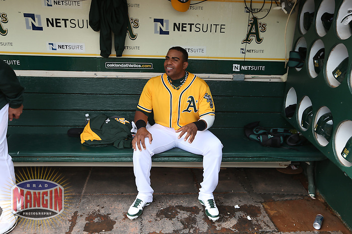 OAKLAND, CA - APRIL 4:  Yoenis Cespedes #52 of the Oakland Athletics sits in the dugout before the game against the Seattle Mariners at O.co Coliseum on April 4, 2013 in Oakland, California. Photo by Brad Mangin