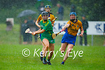 Kerry's Rachel McCarthy in possession as Clare's Sarah Ní Ceallaigh attempts to block her effort during a downpour in the Munster Junior Camogie final
