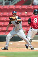Tennessee first baseman Jesus Cota waits for a late throw as Carolina's Jose Campusano beats out an infield hit at Five County Stadium in Zebulon, NC, Sunday, July 2, 2006.  The Mudcats defeated the Smokies 4-0.