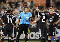 Santino Quaranta #25 of D.C. United talks with referee Alex Prus during an MLS match against the Houston Dynamo at RFK Stadium in Washington D.C. on September  25 2010.Houston won 3-1.