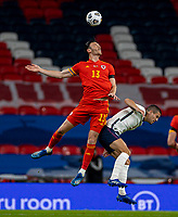 8th Occtober 2020, Wembley Stadium, London, England;  Wales Kieffer Moore challenges for a header with Englands Conor Coady during a friendly match between England and Wales in London