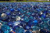 Switzerland. Blue glass pebbles in sunlight.