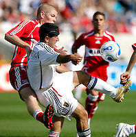 Real Salt Lake's Alecko Eskandarian (9) receives the ball while being pressured by Chicago Fire defender Jeff Curtin (19).  The Chicago Fire and Real Salt Lake tied 0-0 at Toyota Park in Bridgeview, IL on May 27, 2007.