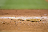 A baseball bat lies on the ground near home plate during the International League game between the Syracuse Chiefs and the Charlotte Knights at BB&T BallPark on June 1, 2016 in Charlotte, North Carolina.  The Knights defeated the Chiefs 5-3.  (Brian Westerholt/Four Seam Images)