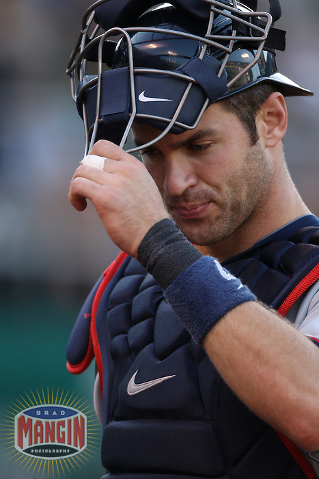 OAKLAND, CA - JULY 30:  Joe Mauer #7 of the Minnesota Twins works behind the plate against the Oakland Athletics during the game at the Oakland-Alameda County Coliseum on July 30, 2011 in Oakland, California. Photo by Brad Mangin