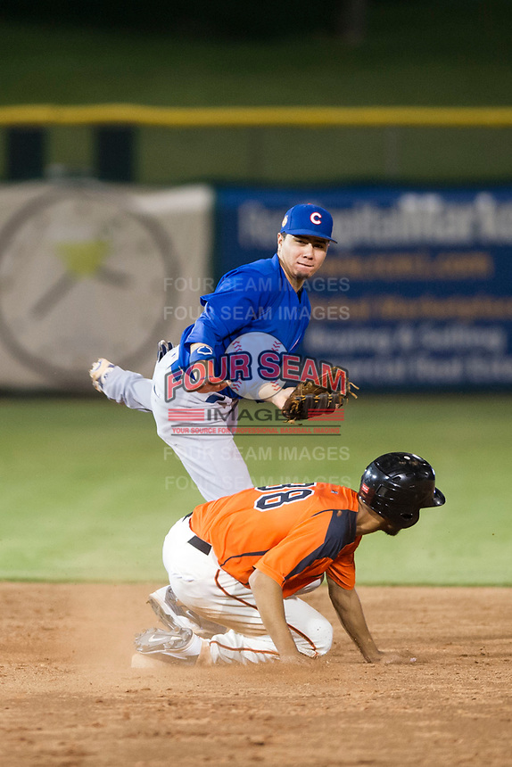 AZL Cubs second baseman Carlos Sepulveda (16) avoids a slide by Aaron Bond on a double play attempt against the AZL Giants on September 5, 2017 at Scottsdale Stadium in Scottsdale, Arizona. AZL Cubs defeated the AZL Giants 10-4 to take a 1-0 lead in the Arizona League Championship Series. (Zachary Lucy/Four Seam Images)