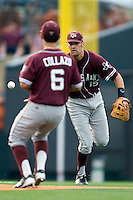Texas A&M Aggies shortstop Kenny Jackson #15 flips the ball to second baseman Andrew Collazo #6 against the Texas Longhorns in NCAA Big XII Conference baseball on May 21, 2011 at Disch Falk Field in Austin, Texas. (Photo by Andrew Woolley / Four Seam Images)