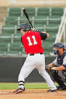 Chris Curley (11) of the Kannapolis Intimidators at bat against the Rome Braves at CMC-Northeast Stadium on August 5, 2012 in Kannapolis, North Carolina.  The Intimidators defeated the Braves 9-1.  (Brian Westerholt/Four Seam Images)