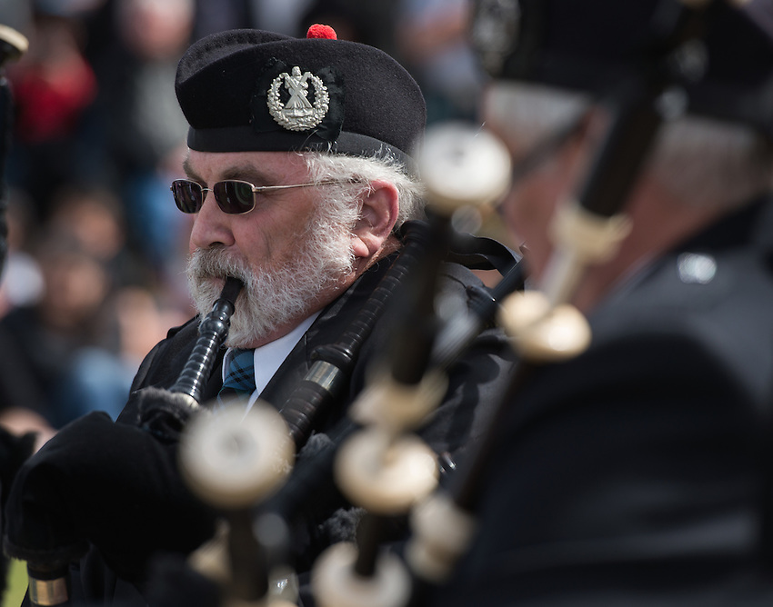 John Leeney plays with the Anchorage Scottish Pipe Band during the 2015 Alaska Scottish Highland Games pipe band competition at the Palmer fairgrounds.