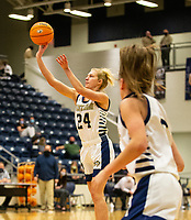 Madison Phillips (24) of Bentonville West takes a 3 point shot against Rogers at Wolverine Arena, Centerton,  AR, Tuesday, January 12, 2021 / Special to NWA Democrat-Gazette/ David Beach