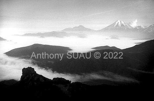 Kamchatka.Siberia, Russia.1995.Sunset on the moutain tops of the Komchatka peninsula in far eastern Siberia. This penincula is nearly untouched by humans and has 27 active volcanos. It was a closed region until 1992 in the former Soviet times.