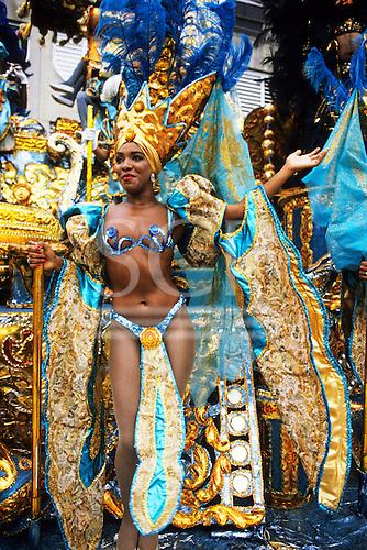 Rio de Janeiro, Brazil. Carnival Samba School; girl with turquoise and gold bikini costume.