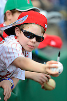 Philadelphia Phillies young fan reaching out for autographs before a Spring Training game against the Boston Red Sox at Bright House Field on March 24, 2013 in Clearwater, Florida.  Boston defeated Philadelphia 7-6.  (Mike Janes/Four Seam Images)