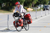 Jim Klinger, of Bella Vista, rides the Razorback Greenway Wednesday, July 14, 2021, on a training ride with all of his gear and panniers through Springdale. Klinger is planning to ride from Astoria, OR. to Yorktown, VA. with Greg Parker beginning August 2. Klinger said it will take 90 days to complete the 4,200 mile self-supported trip. Check out nwaonline.com/210715Daily/ and nwadg.com/photos for a photo gallery.(NWA Democrat-Gazette/David Gottschalk)